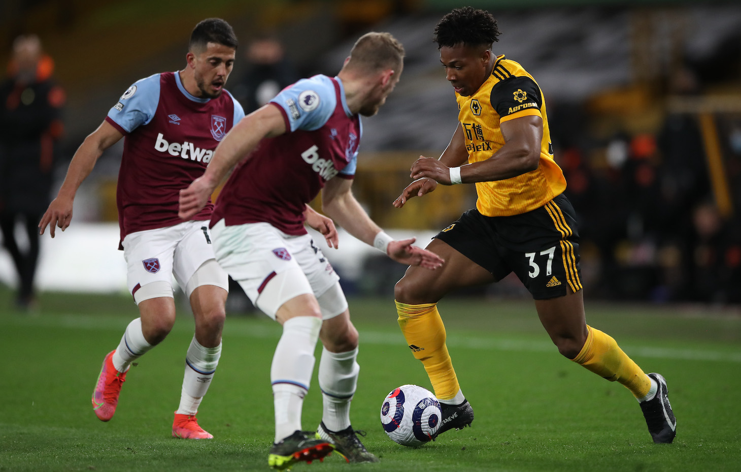 Adama Traore of Wolverhampton Wanderers is challenged by Pablo Fornals and Vladimir Coufal of West Ham during the Premier League match between Wolverhampton Wanderers and West Ham United at Molineux on April 05, 2021 in Wolverhampton, England.