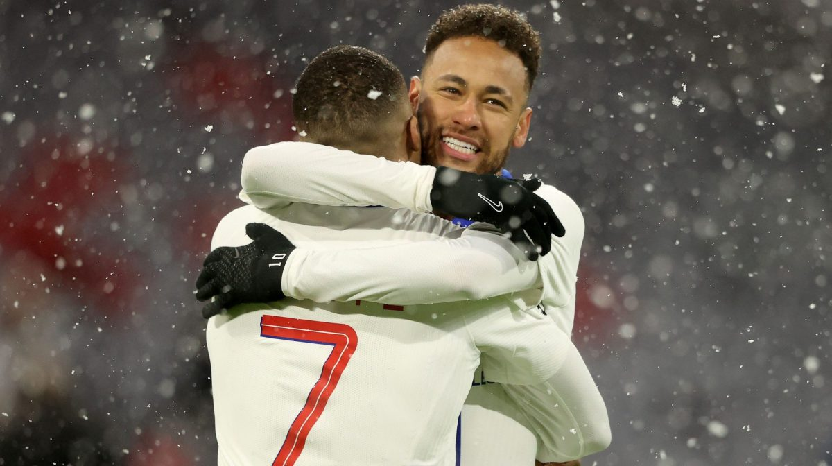 Kylian Mbappe of Paris Saint-Germain celebrates after scoring their side's first goal with his team mate Neymar during the UEFA Champions League Quarter Final match between FC Bayern Munich and Paris Saint-Germain at Allianz Arena on April 07, 2021 in Munich, Germany.