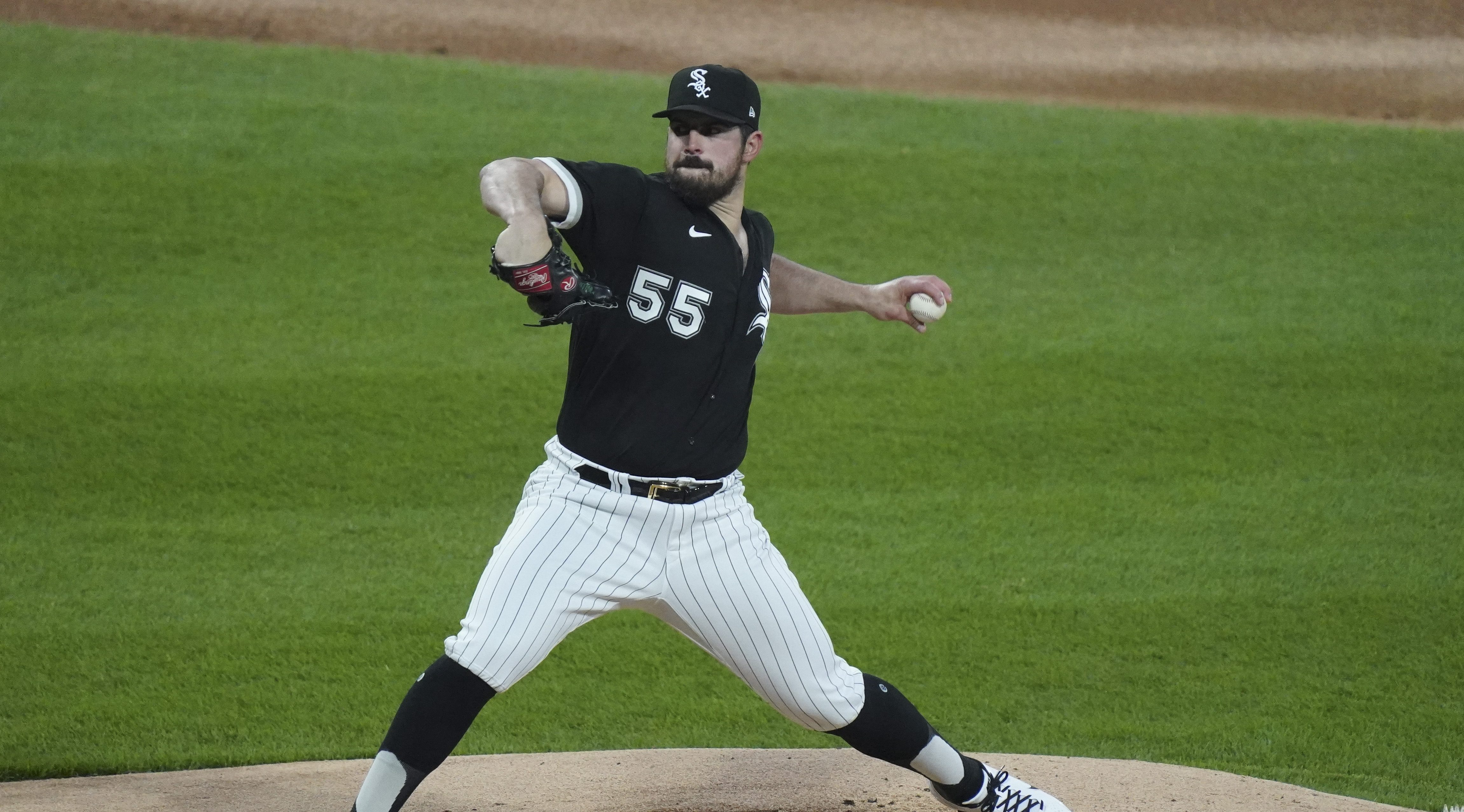 Carlos Rodon stretches through his pitching motion toward home.