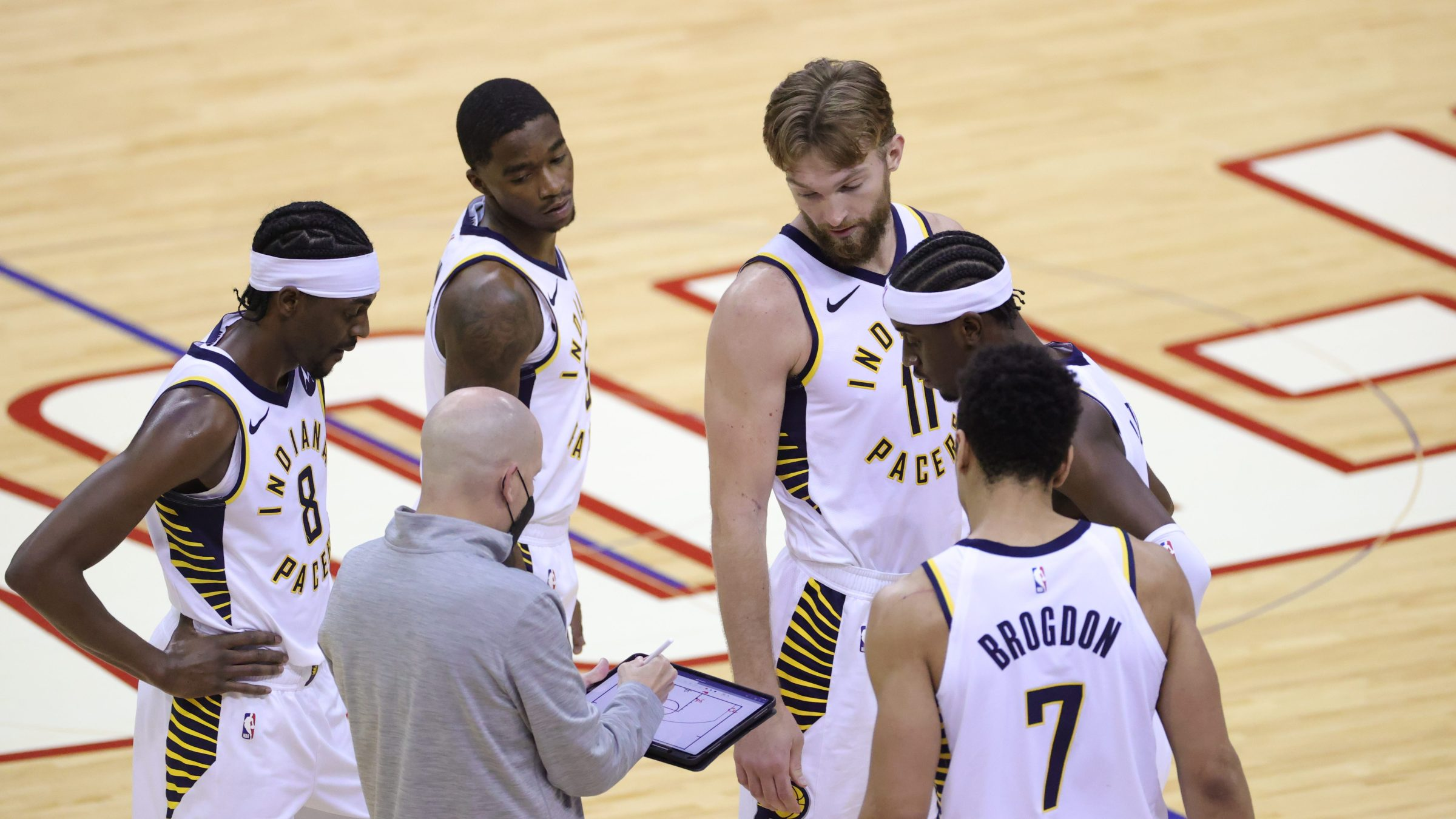 Head coach Nate Bjorkgren diagrams a play for the Indiana Pacers during a timeout