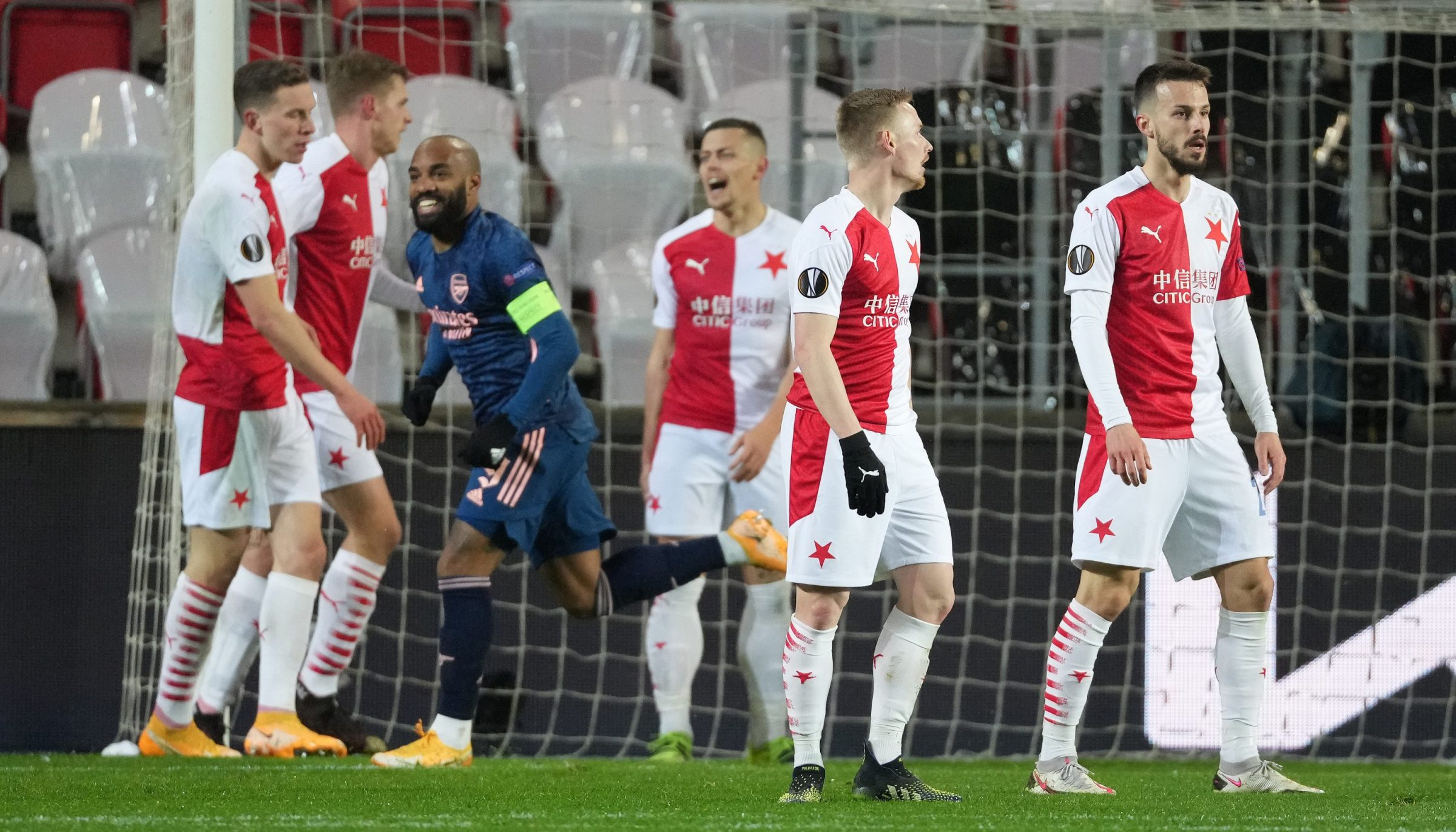 Players of Slavia Praha look dejected after Alexandre Lacazette of Arsenal scored his team's second goal from the penalty spot during the UEFA Europa League Quarter Final Second Leg match between Slavia Praha and Arsenal FC at Sinobo Stadium on April 15, 2021 in Prague, Czech Republic