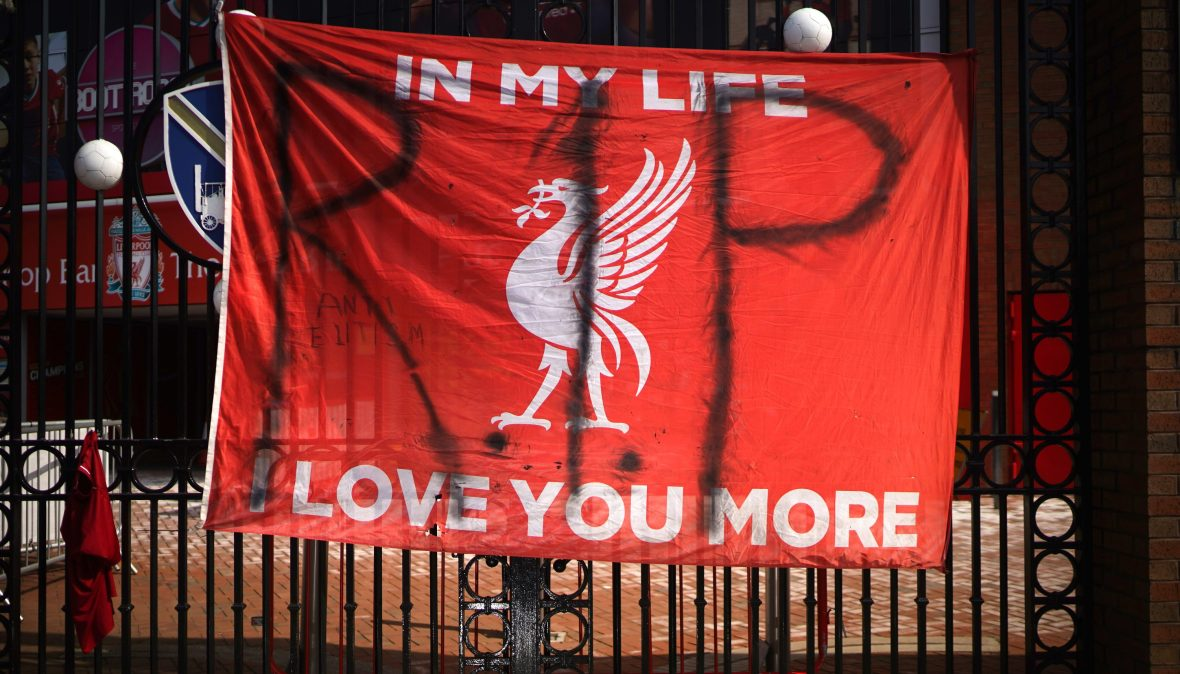 Banners and football scarves are tied to the fences around Anfield Stadium, the home of Liverpool Football Club, in protest at the club's intentions to join the European Super League on April 20, 2021 in Liverpool, United Kingdom.
