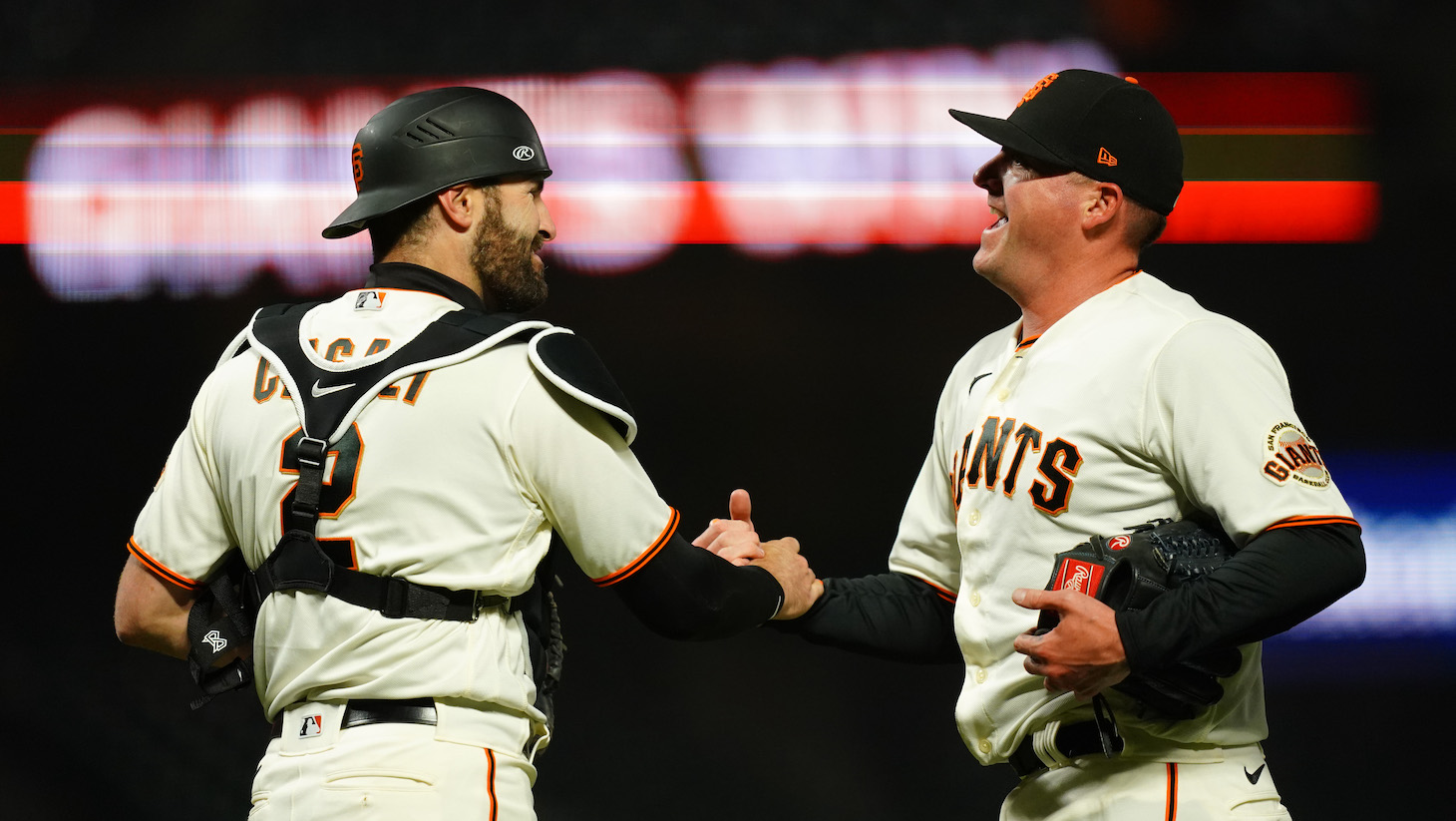 SAN FRANCISCO, CALIFORNIA - APRIL 22: Jake McGee #17 and Curt Casali #2 of the San Francisco Giants celebrate beating the Miami Marlins at Oracle Park on April 22, 2021 in San Francisco, California. (Photo by Daniel Shirey/Getty Images)