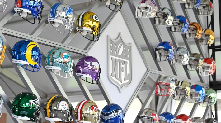 CLEVELAND, OHIO - APRIL 28: Wall of NFL team helmets on display inside the NFL Locker Room at the NFL Draft Experience on April 28, 2021 in Cleveland, Ohio. (Photo by Duane Prokop/Getty Images)