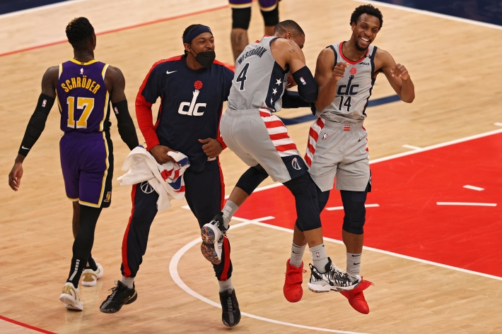 Russell Westbrook, Ish Smith, and Bradley Beal celebrate during the Wizards' win over the Lakers.