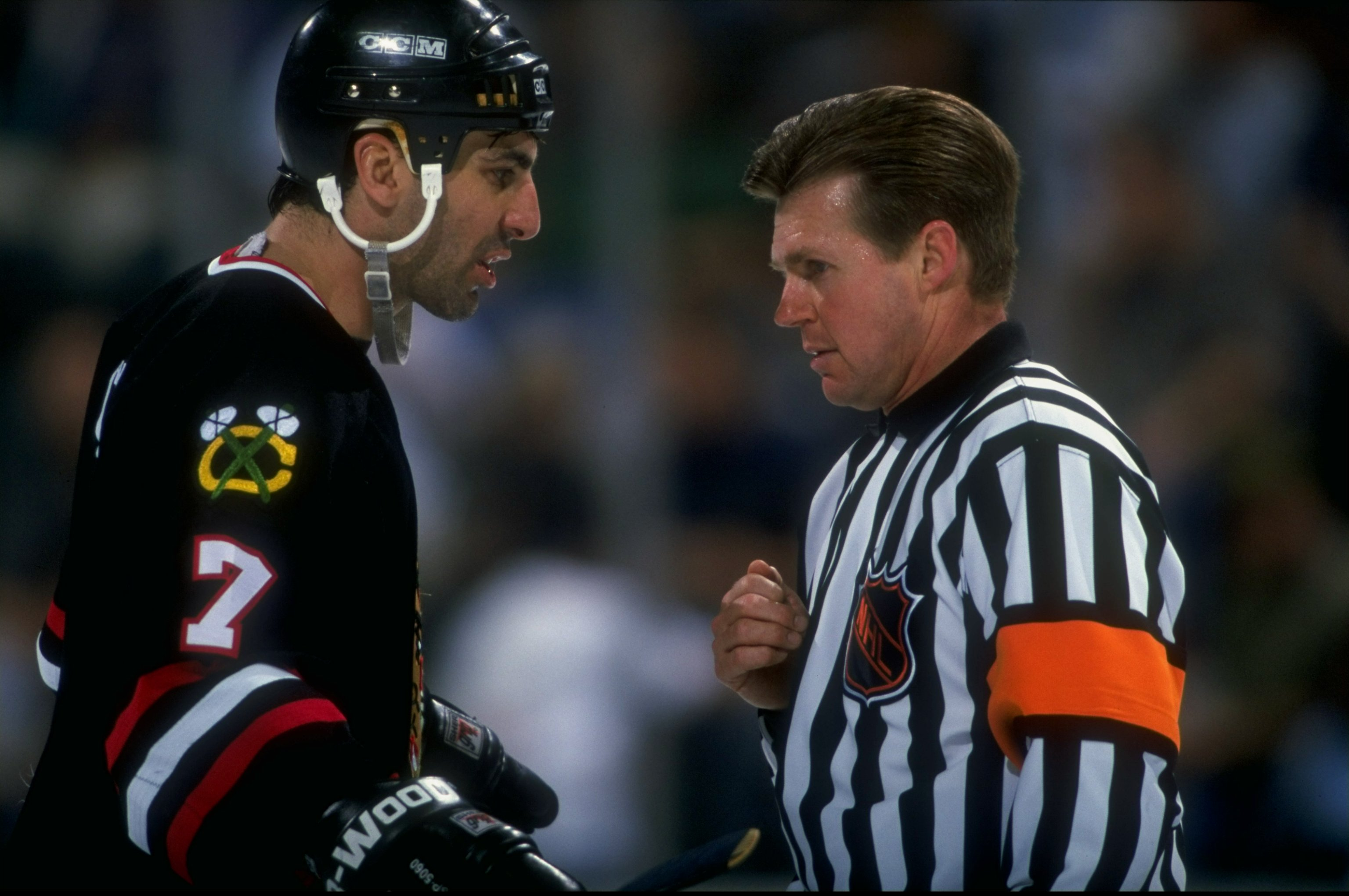 Chris Chelios talks with a referee