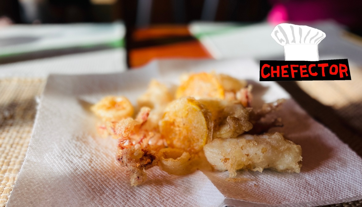 A bunch of fried seafood and lemons, with the Chefector badge