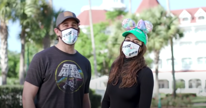A screenshot of Aaron Rodgers and Shailene Woodley at Disney World. They are both wearing masks.
