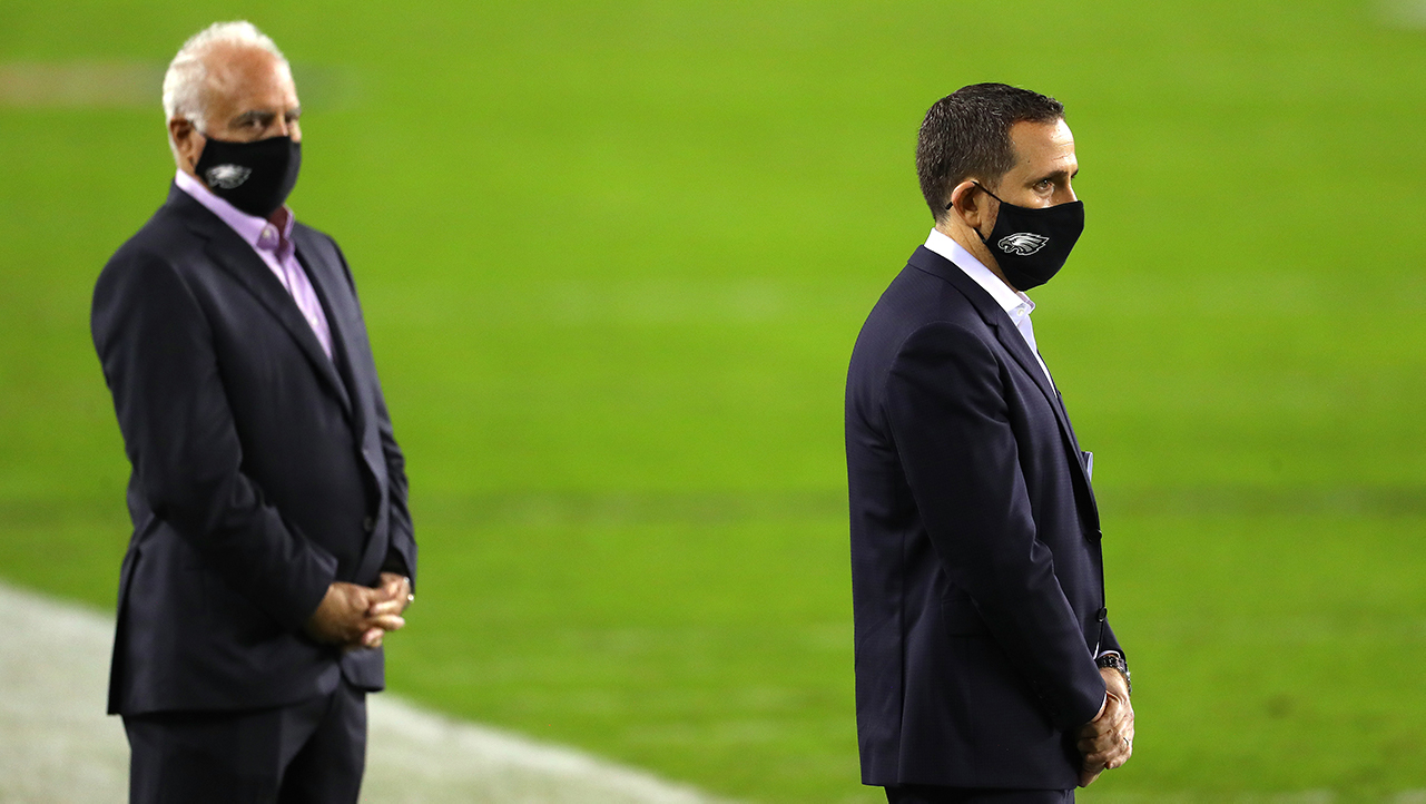 Jeffrey Lurie (Eagles owner) and Howie Roseman (Eagles GM, basically) stand in suits on the sideline. It's 2020 so they're wearing masks.