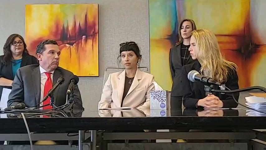A photo of license massage therapist Ashley Solis as she speaks at a press conference. Solis described the quarterback of the Houston Texans, Deshaun Watson, forcing her to touch his penis during a massage he had hired her to provide. On her left and her right are the attorneys representing her.