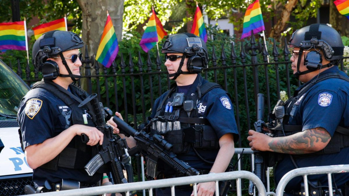 NYPD officers patrol before the Queer Liberation March