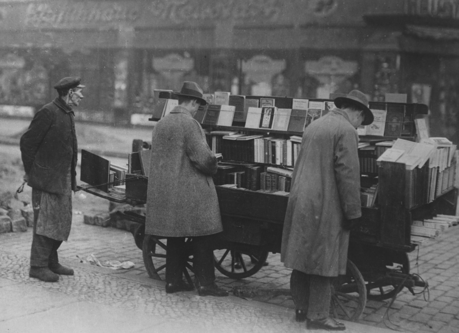 Customers browse at a mobile book stall, Berlin, circa 1925.