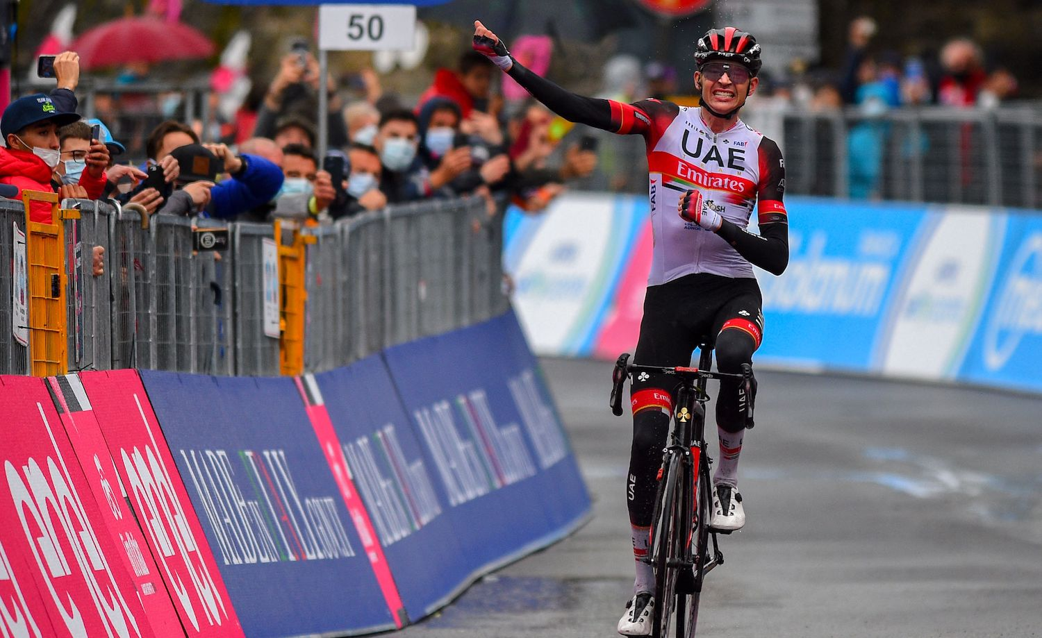 Team UAE Emirates rider US Joe Dombrowski celebrates as he crosses the finish line to win the fourth stage of the Giro d'Italia 2021 cycling race, 187 km between Piacenza and Sestola, Emilia-Romagna, on May 11, 2021. (Photo by Dario BELINGHERI / AFP) (Photo by DARIO BELINGHERI/AFP via Getty Images)