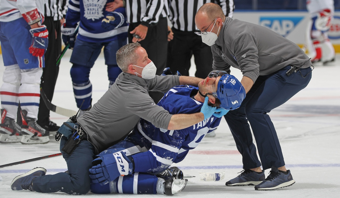 TORONTO, ON - MAY 20: John Tavares #91 of the Toronto Maple Leafs appears to suffer a significant injury against the Montreal Canadiens in Game One of the First Round of the 2021 Stanley Cup Playoffs at Scotiabank Arena on May 20, 2021 in Toronto, Ontario, Canada. (Photo by Claus Andersen/Getty Images) *** Local Caption *** John Tavares