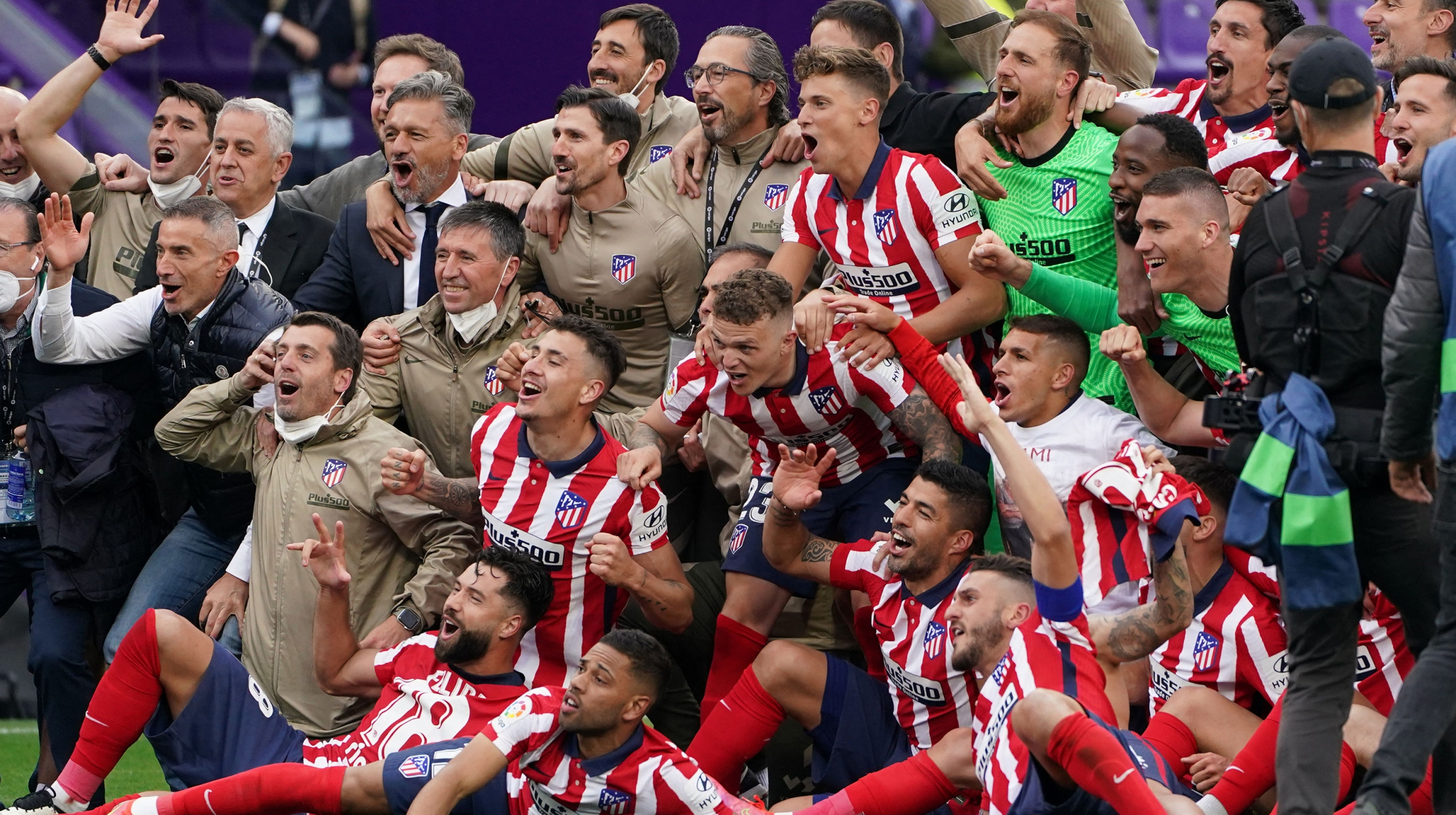 Atletico Madrid's players celebrate after winning the Spanish league football match against Real Valladolid FC and the Liga Championship title at the Jose Zorilla stadium in Valladolid on May 22, 2021.