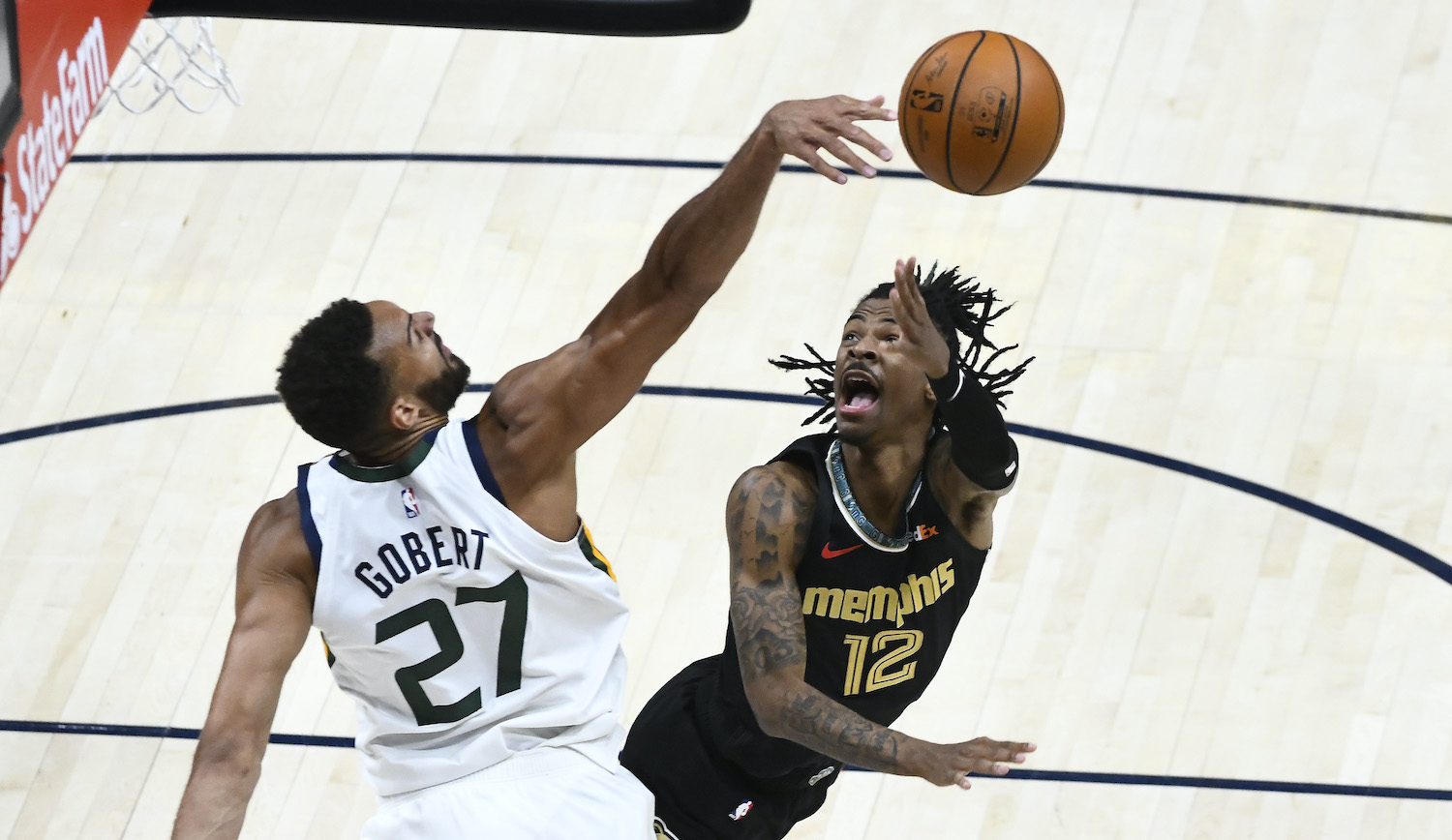 SALT LAKE CITY, UTAH - MAY 23: Rudy Gobert #27 of the Utah Jazz blocks Ja Morant #12 of the Memphis Grizzlies in Game One of the Western Conference first-round playoff series at Vivint Smart Home Arena on May 23, 2021 in Salt Lake City, Utah. NOTE TO USER: User expressly acknowledges and agrees that, by downloading and/or using this photograph, user is consenting to the terms and conditions of the Getty Images License Agreement. (Photo by Alex Goodlett/Getty Images)
