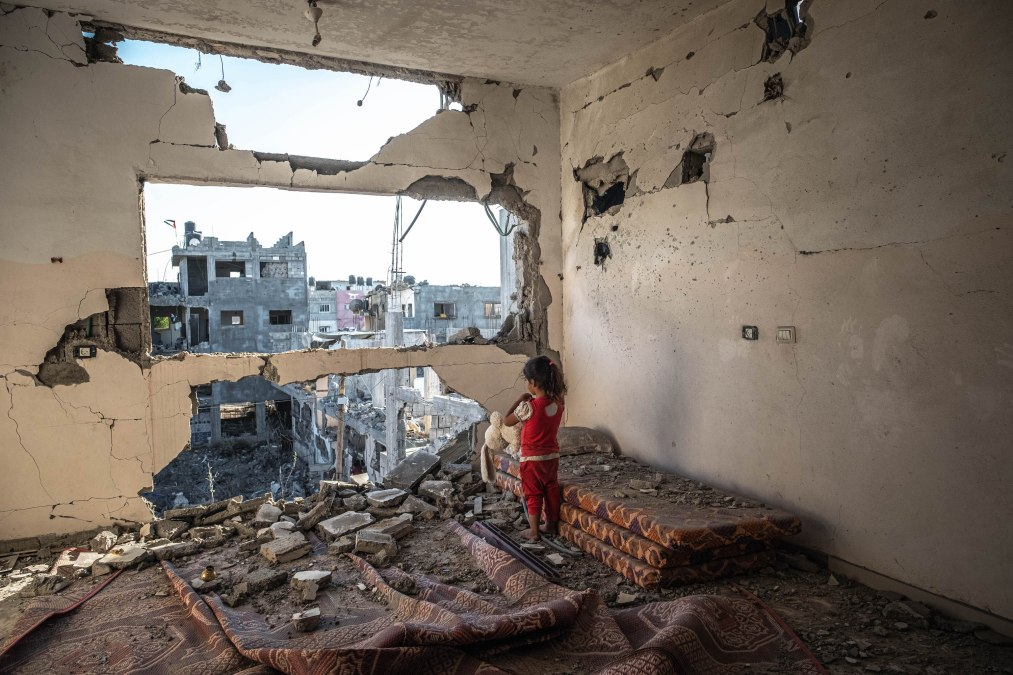 A Palestinian girl stands amid the rubble of her destroyed house in Beit Hanun town northern Gaza Strip,on May 24, 2021 in Gaza City, Gaza