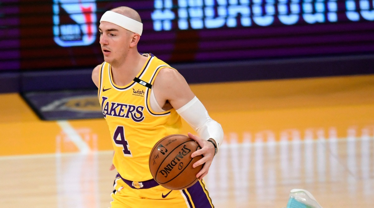 LOS ANGELES, CALIFORNIA - APRIL 19: Alex Caruso #4 of the Los Angeles Lakers brings the ball up court during the game against the Utah Jazz at Staples Center on April 19, 2021 in Los Angeles, California. NOTE TO USER: User expressly acknowledges and agrees that, by downloading and or using this photograph, User is consenting to the terms and conditions of the Getty Images License Agreement. (Photo by Harry How/Getty Images)