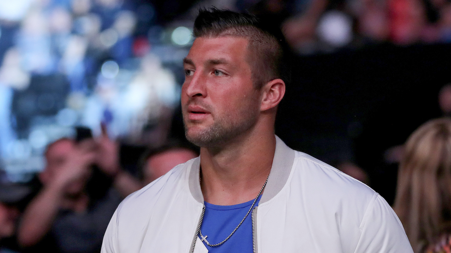 JACKSONVILLE, FL - APRIL 24: Tim Tebow is seen by the octagon during UFC 261 at VyStar Veterans Memorial Arena on April 24, 2021 in Jacksonville, Florida. (Photo by Alex Menendez/Getty Images)