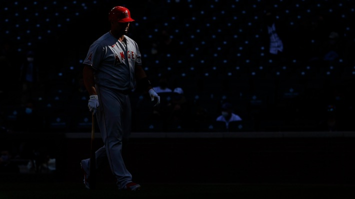 SEATTLE, WASHINGTON - MAY 02: Albert Pujols #5 of the Los Angeles Angels walks to the dugout after striking out against the Seattle Mariners ninth inning at T-Mobile Park on May 02, 2021 in Seattle, Washington. (Photo by Steph Chambers/Getty Images)