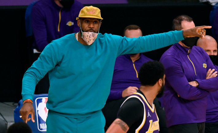 LOS ANGELES, CALIFORNIA - MAY 11: LeBron James #23 of the Los Angeles Lakers reacts to play behind Anthony Davis #3 during the third quarter against the New York Knicks at Staples Center on May 11, 2021 in Los Angeles, California. (Photo by Harry How/Getty Images)