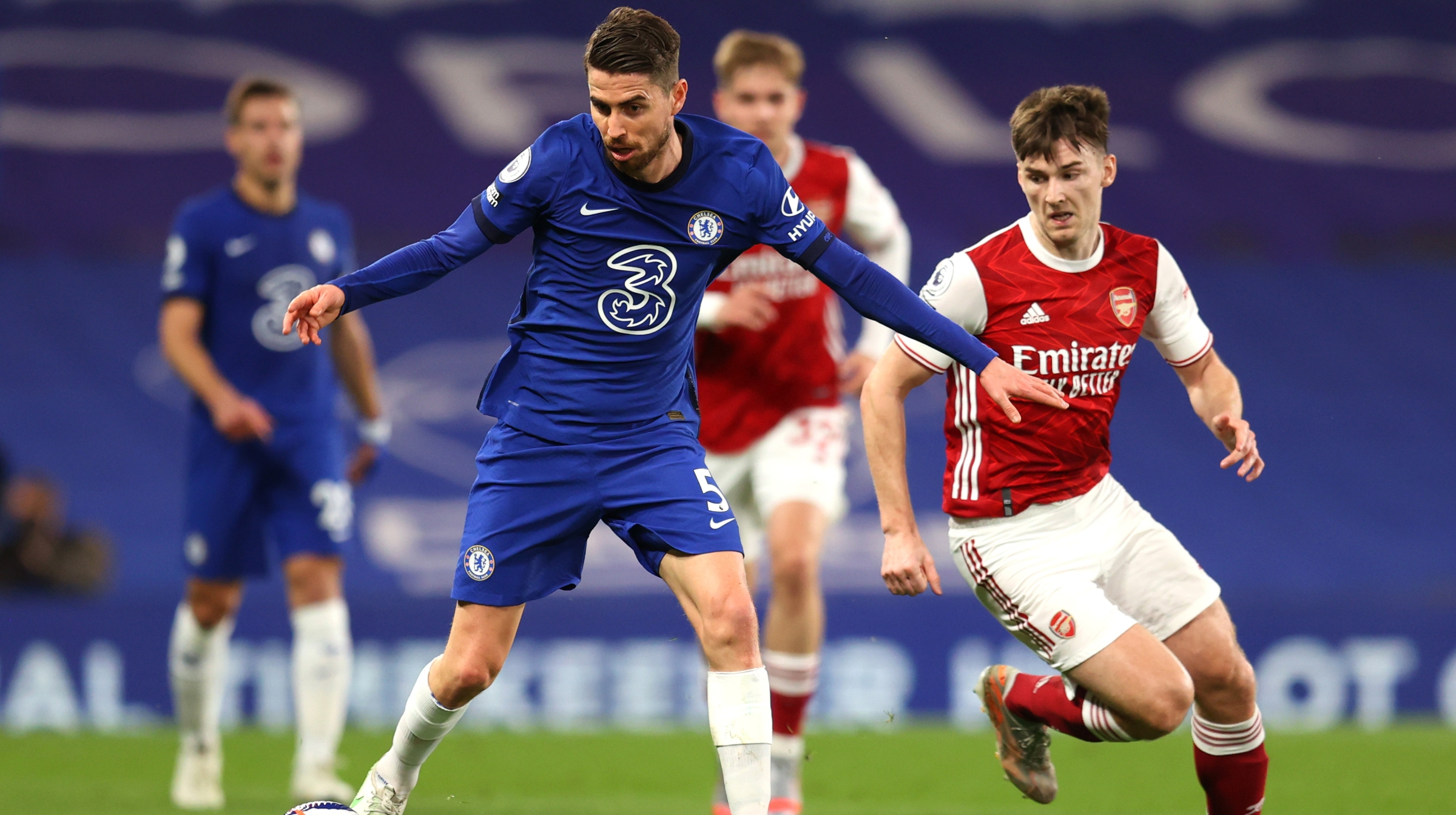 Jorginho of Chelsea battles for possession with Kieran Tierney of Arsenal during the Premier League match between Chelsea and Arsenal at Stamford Bridge on May 12, 2021 in London, England.