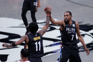Kyrie Irving and Kevin Durant exchange a high-five