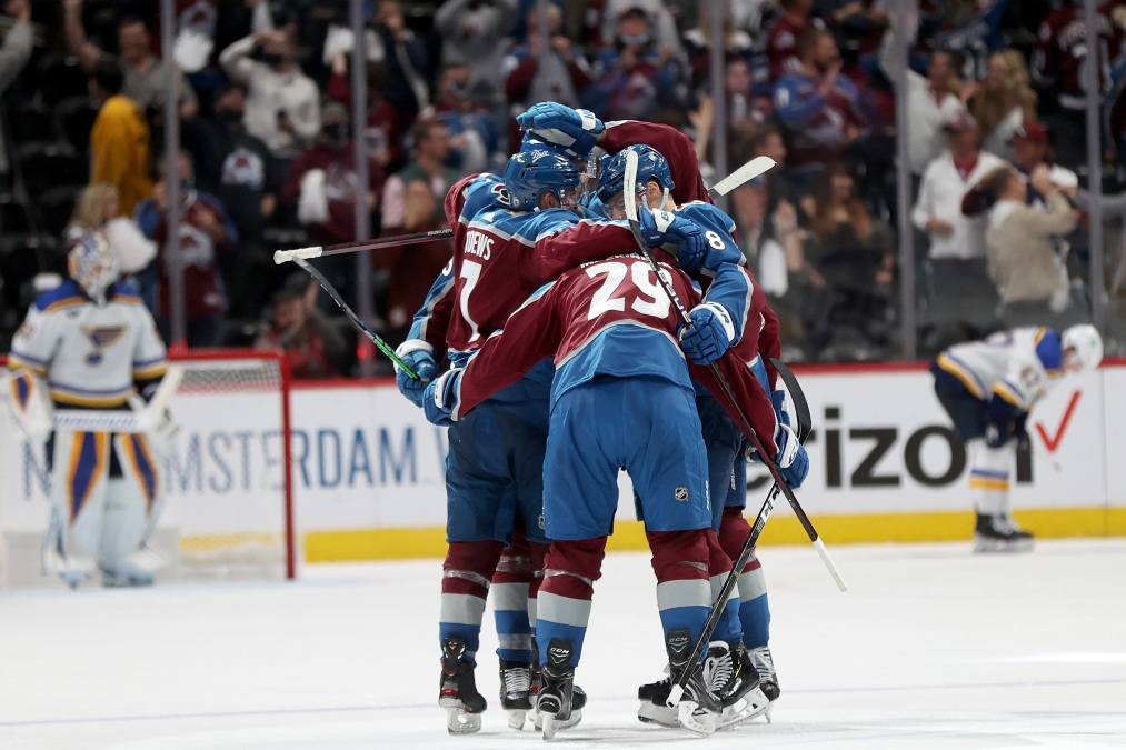 The Colorado Avalanche celebrate a goal by Nathan MacKinnon
