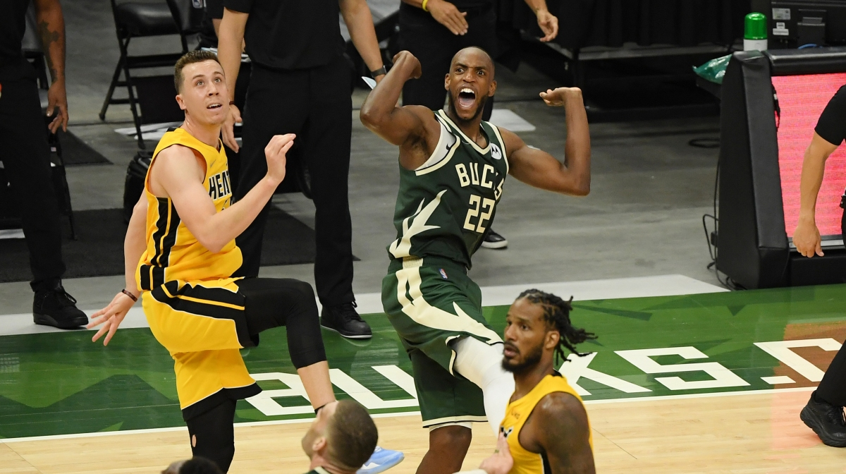 Khris Middleton #22 of the Milwaukee Bucks reacts after scoring in overtime against Duncan Robinson #55 of the Miami Heat during Game 1 of their Eastern Conference first-round playoff series between the Milwaukee Bucks and the Miami Heat at Fiserv Forum on May 22, 2021 in Milwaukee, Wisconsin.