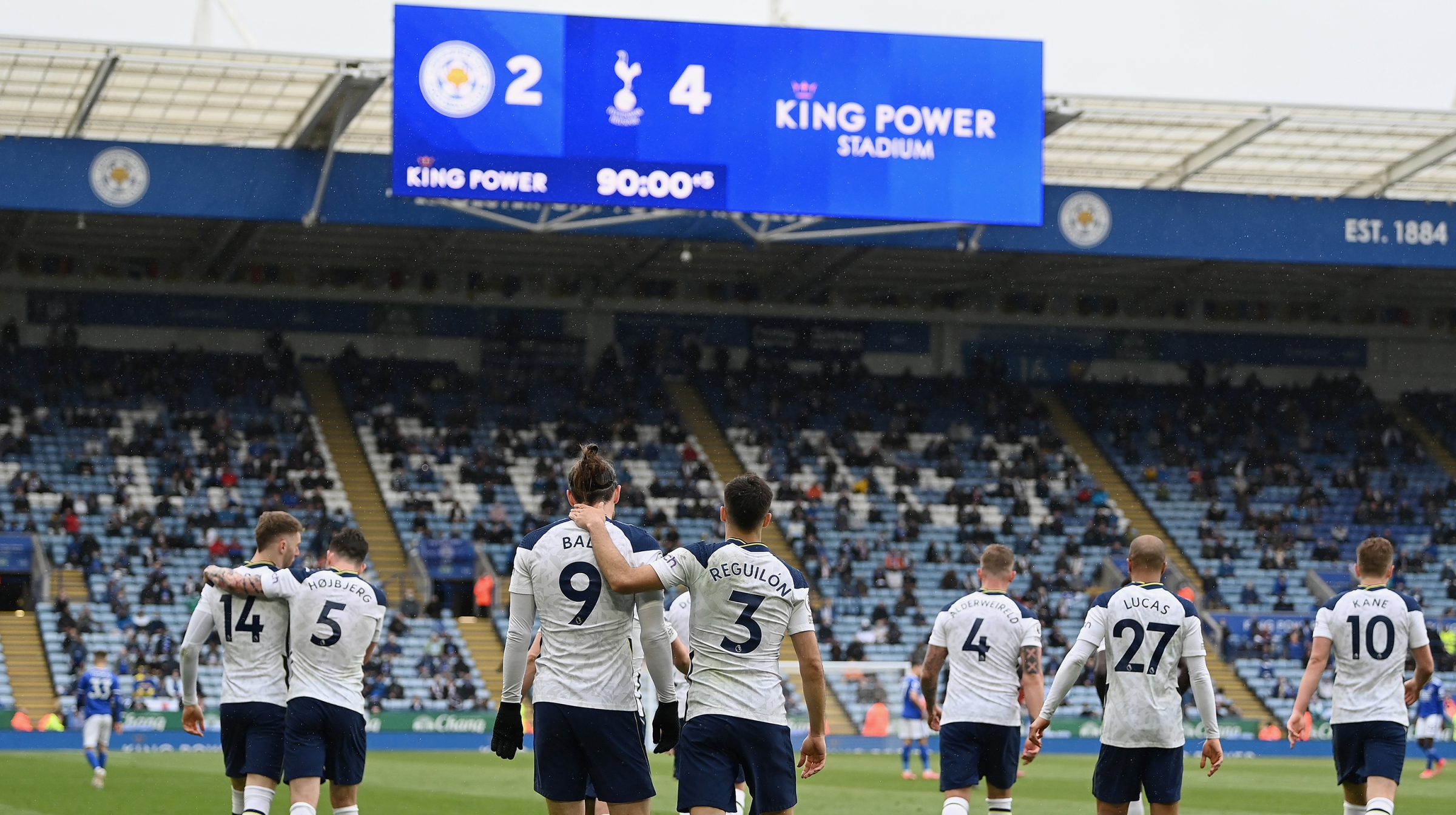 Gareth Bale of Tottenham Hotspur celebrates with teammate Sergio Reguilon after scoring his team's fourth goal during the Premier League match between Leicester City and Tottenham Hotspur at The King Power Stadium on May 23, 2021 in Leicester, England.