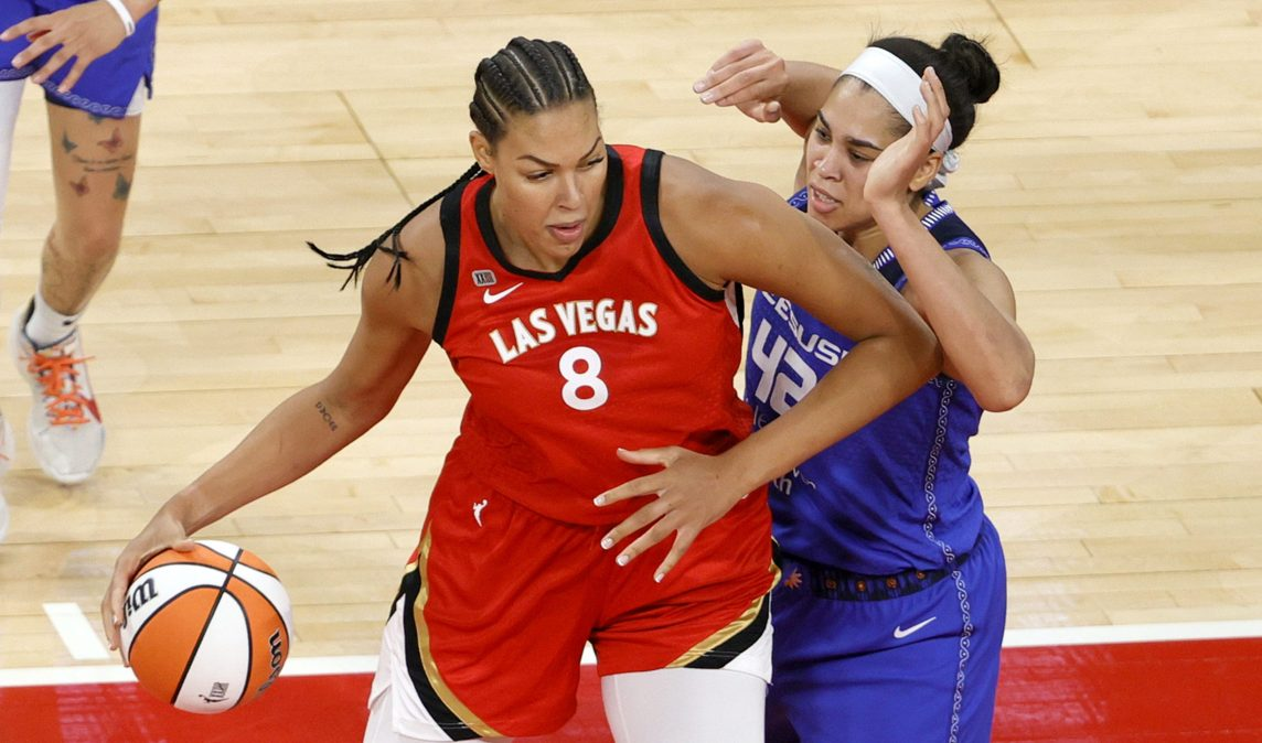 Liz Cambage #8 of the Las Vegas Aces is guarded by Brionna Jones #42 of the Connecticut Sun during their game at Michelob ULTRA Arena on May 23, 2021 in Las Vegas, Nevada. The Sun defeated the Aces 72-65.