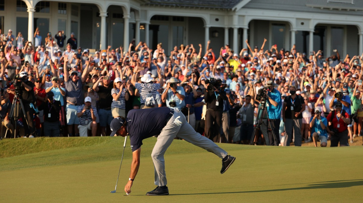 KIAWAH ISLAND, SOUTH CAROLINA - MAY 23: Phil Mickelson of the United States retrieves his golf ball on the 18th green after putting to win during the final round of the 2021 PGA Championship held at the Ocean Course of Kiawah Island Golf Resort on May 23, 2021 in Kiawah Island, South Carolina. (Photo by Patrick Smith/Getty Images)