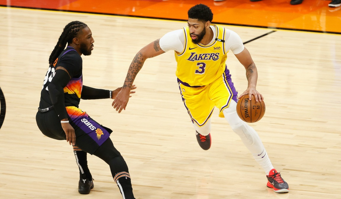 PHOENIX, ARIZONA - MAY 25: Anthony Davis #3 of the Los Angeles Lakers drives the ball against Jae Crowder #99 of the Phoenix Suns during the second half of Game Two of the Western Conference first-round playoff series at Phoenix Suns Arena on May 25, 2021 in Phoenix, Arizona. NOTE TO USER: User expressly acknowledges and agrees that, by downloading and or using this photograph, User is consenting to the terms and conditions of the Getty Images License Agreement. (Photo by Christian Petersen/Getty Images)