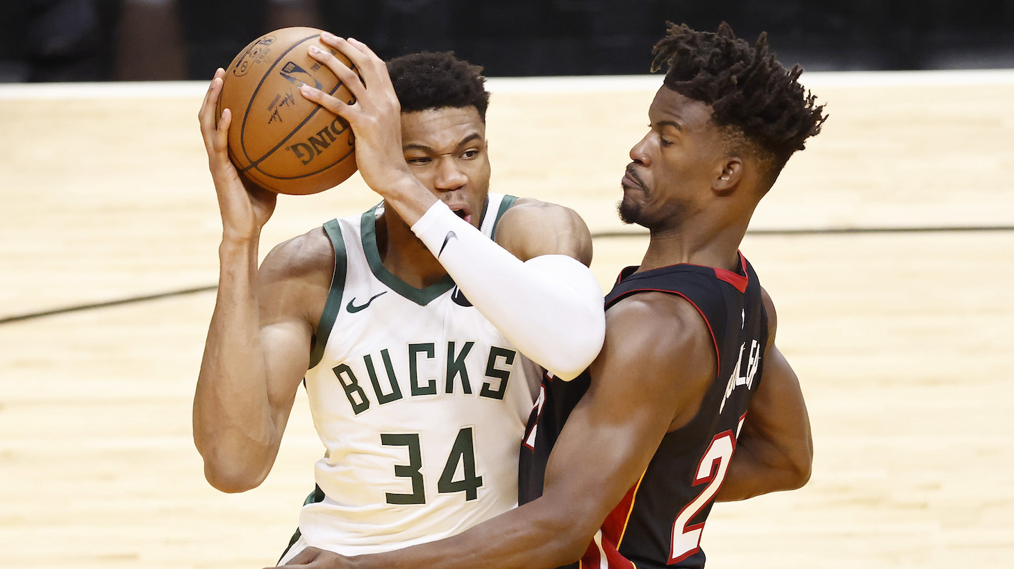 MIAMI, FLORIDA - MAY 27: Giannis Antetokounmpo #34 of the Milwaukee Bucks drives to the basket against Jimmy Butler #22 of the Miami Heat during the third quarter in Game Three of the Eastern Conference first-round playoff series at American Airlines Arena on May 27, 2021 in Miami, Florida. NOTE TO USER: User expressly acknowledges and agrees that, by downloading and or using this photograph, User is consenting to the terms and conditions of the Getty Images License Agreement. (Photo by Michael Reaves/Getty Images)