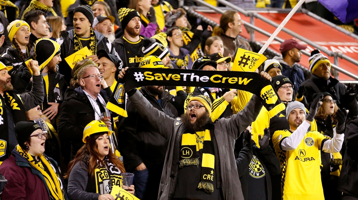 A fan of the Columbus Crew SC holds up a scarf showing his support for keeping the team in Columbus prior to the start of the match between the Columbus Crew SC and the Toronto FC at MAPFRE Stadium on November 21, 2017 in Columbus, Ohio.