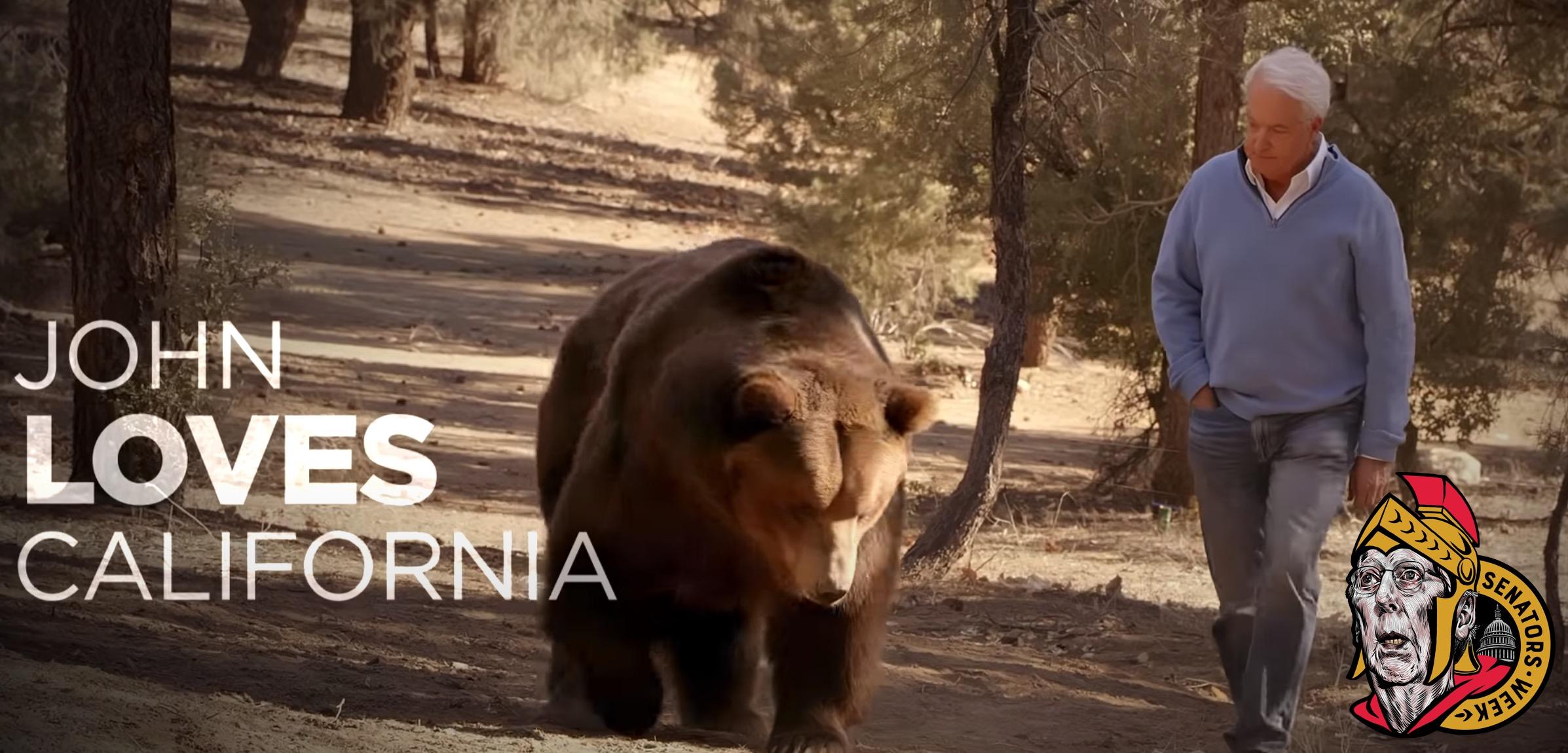 John Cox with a bear