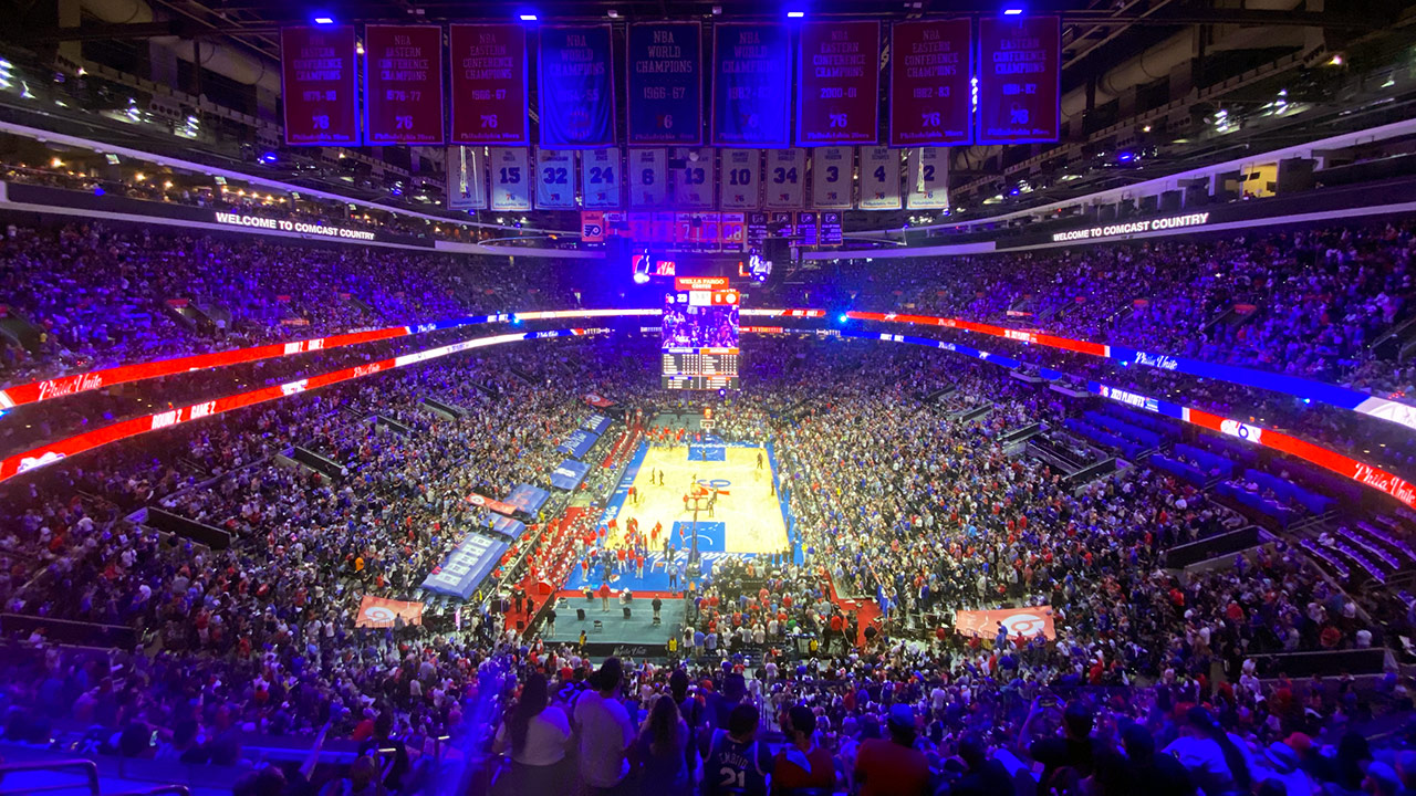 The 76ers arena with the Sixers up 23-6 early in a playoff game. It's full and looks loud. It's a wide shot, with a wide angle lense
