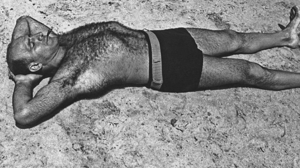 A man sunbathes, circa 1940