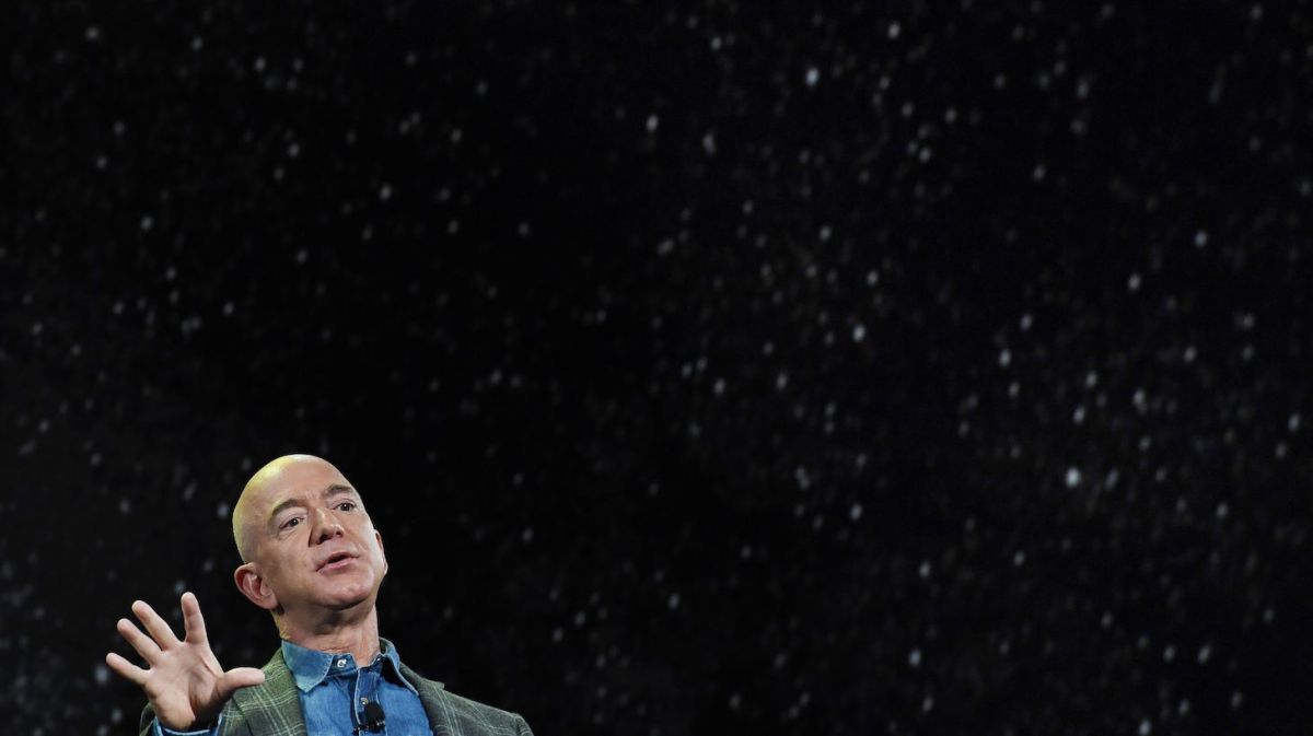 Amazon Founder and CEO Jeff Bezos talks about his 'Blue Origin Space Program' during a keynote session at the Amazon Re:MARS conference on robotics and artificial intelligence at the Aria Hotel in Las Vegas, Nevada on June 6, 2019. (Photo by Mark RALSTON / AFP) (Photo by MARK RALSTON/AFP via Getty Images)