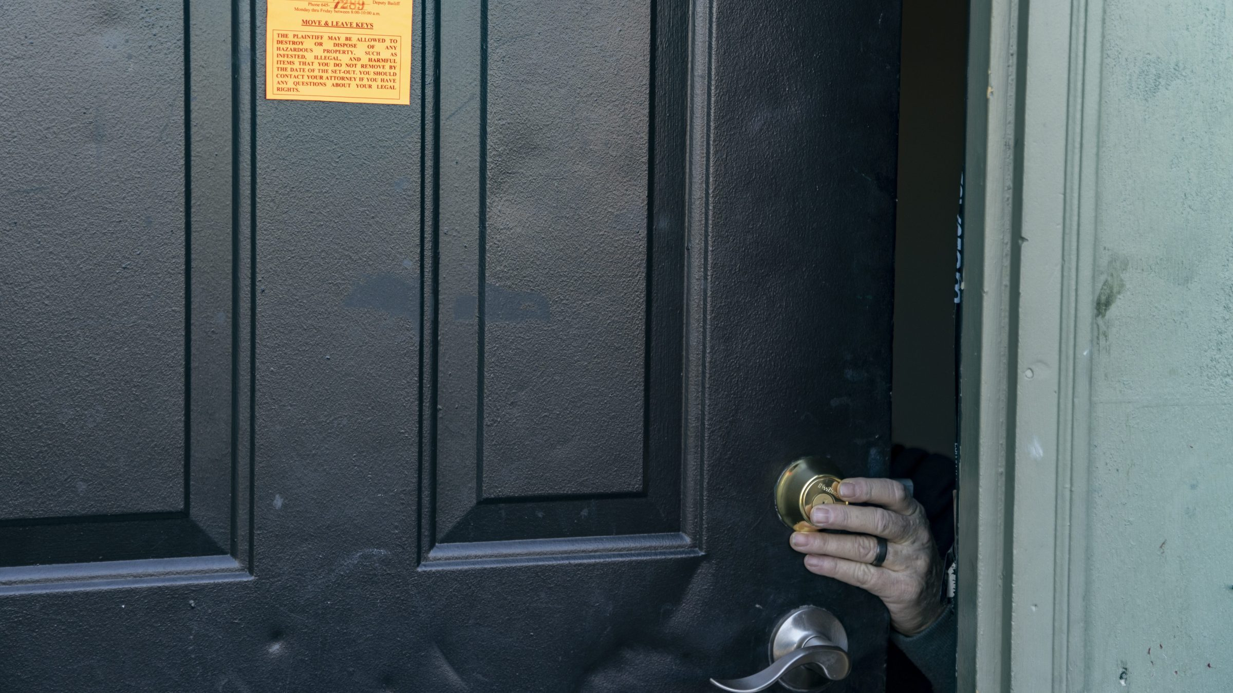 An eviction notice is posted and the lock is changed on a residence in the unincorporated community of Galloway on March 3, 2021 west of Columbus, Ohio.