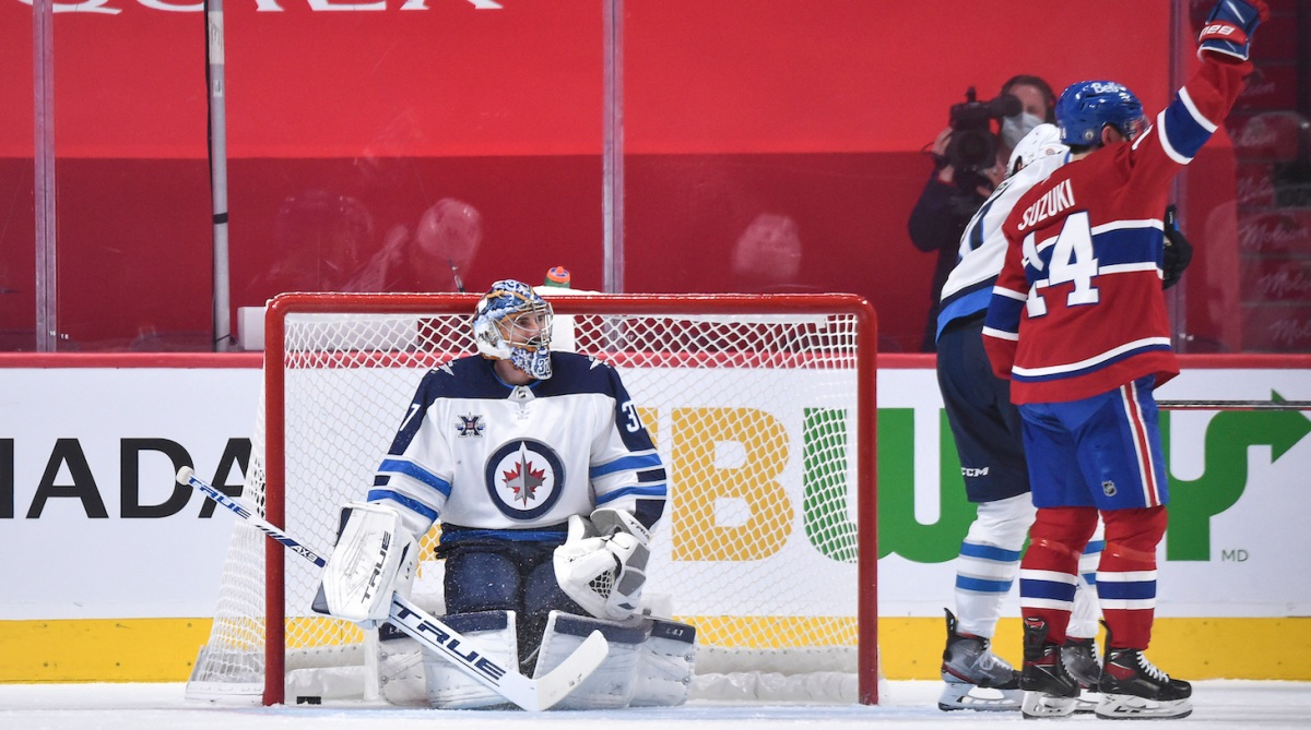 MONTREAL, QC - JUNE 06: Goaltender Connor Hellebuyck #37 of the Winnipeg Jets looks at Nick Suzuki #14 of the Montreal Canadiens as he celebrates his goal during the third period in Game Three of the Second Round of the 2021 Stanley Cup Playoffs at the Bell Centre on June 6, 2021 in Montreal, Canada. The Montreal Canadiens defeated the Winnipeg Jets 5-1. (Photo by Minas Panagiotakis/Getty Images)