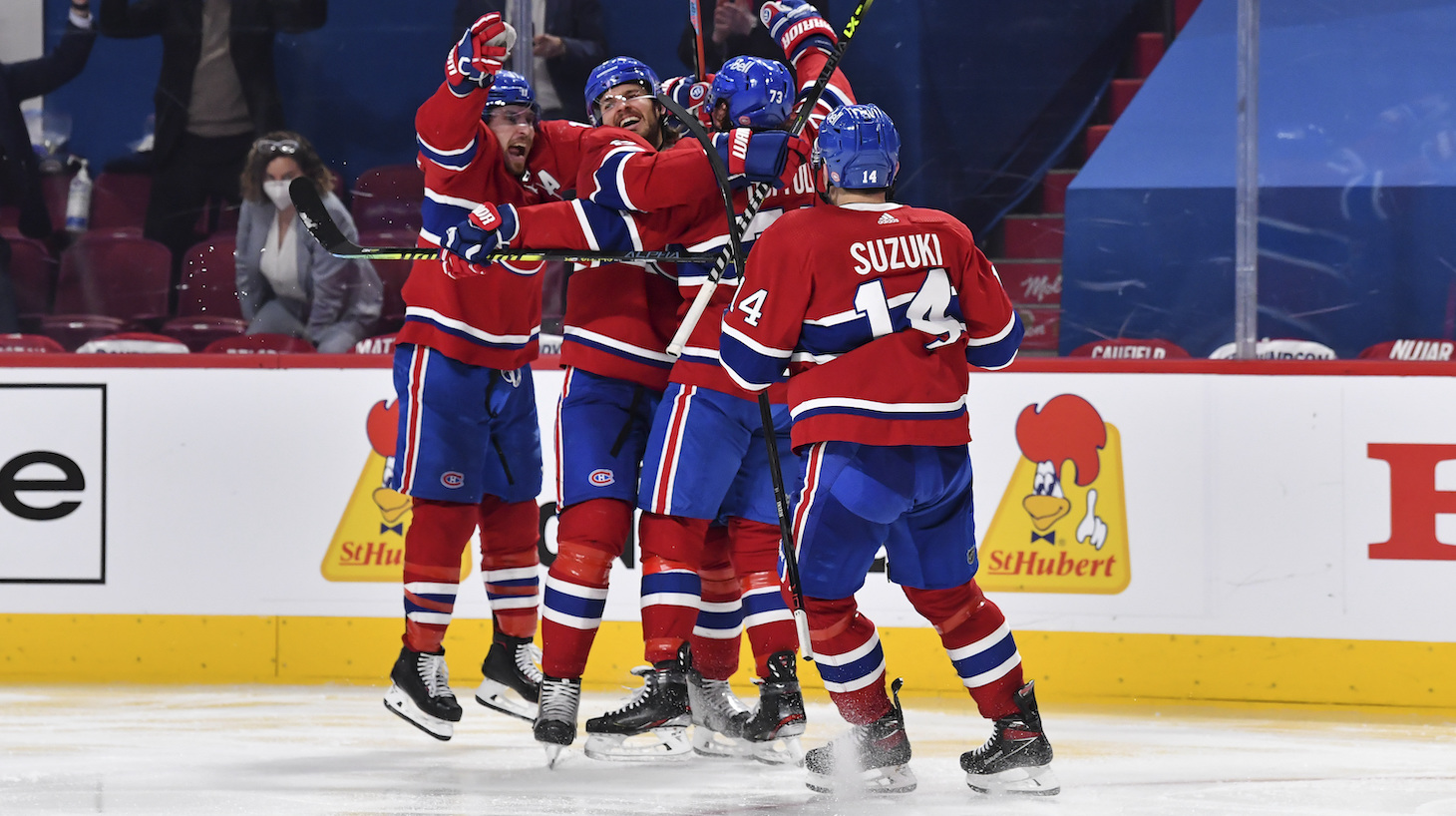 MONTREAL, QC - JUNE 07: The Montreal Canadiens celebrate an overtime victory against the Winnipeg Jets in Game Four of the Second Round of the 2021 Stanley Cup Playoffs at the Bell Centre on June 7, 2021 in Montreal, Canada. The Montreal Canadiens defeated the Winnipeg Jets 3-2 in overtime and eliminate them with a 4-0 series win. (Photo by Minas Panagiotakis/Getty Images)