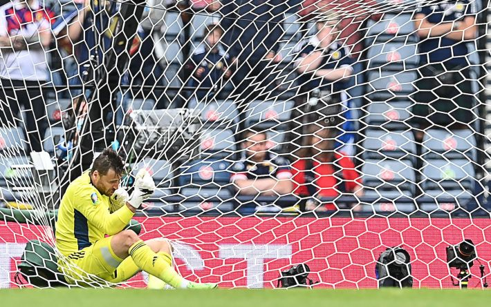 Scotland's goalkeeper David Marshall falls in the net after missing a save on Czech Republic's second goal during the UEFA EURO 2020 Group D football match between Scotland and Czech Republic at Hampden Park in Glasgow on June 14, 2021. (Photo by Paul ELLIS / POOL / AFP) (Photo by PAUL ELLIS/POOL/AFP via Getty Images)