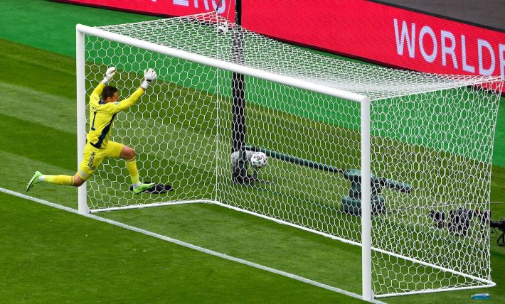 TOPSHOT - Scotland's goalkeeper David Marshall misses a save on Czech Republic's second goal during the UEFA EURO 2020 Group D football match between Scotland and Czech Republic at Hampden Park in Glasgow on June 14, 2021. (Photo by ANDY BUCHANAN / POOL / AFP) (Photo by ANDY BUCHANAN/POOL/AFP via Getty Images)
