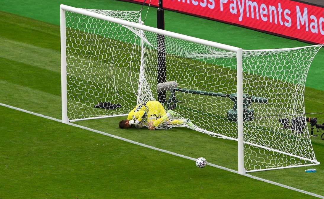 Scotland's goalkeeper David Marshall falls in the net after missing a save on Czech Republic's second goal during the UEFA EURO 2020 Group D football match between Scotland and Czech Republic at Hampden Park in Glasgow on June 14, 2021. (Photo by ANDY BUCHANAN / POOL / AFP) (Photo by ANDY BUCHANAN/POOL/AFP via Getty Images)