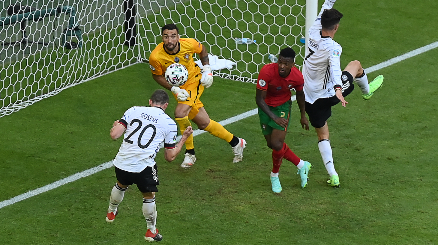 Germany's defender Robin Gosens (L) heads the ball to score their fourth goal during the UEFA EURO 2020 Group F football match between Portugal and Germany at Allianz Arena in Munich on June 19, 2021.