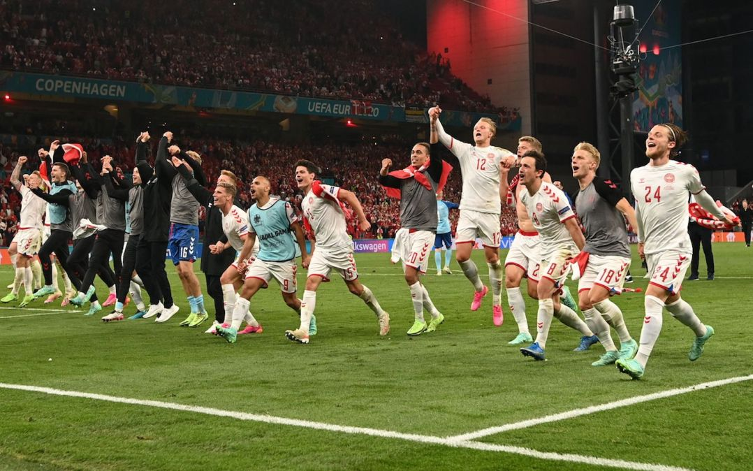 Denmark's players celebrate at the end of the UEFA EURO 2020 Group B football match between Russia and Denmark at Parken Stadium in Copenhagen on June 21, 2021. (Photo by Jonathan NACKSTRAND / POOL / AFP) (Photo by JONATHAN NACKSTRAND/POOL/AFP via Getty Images)