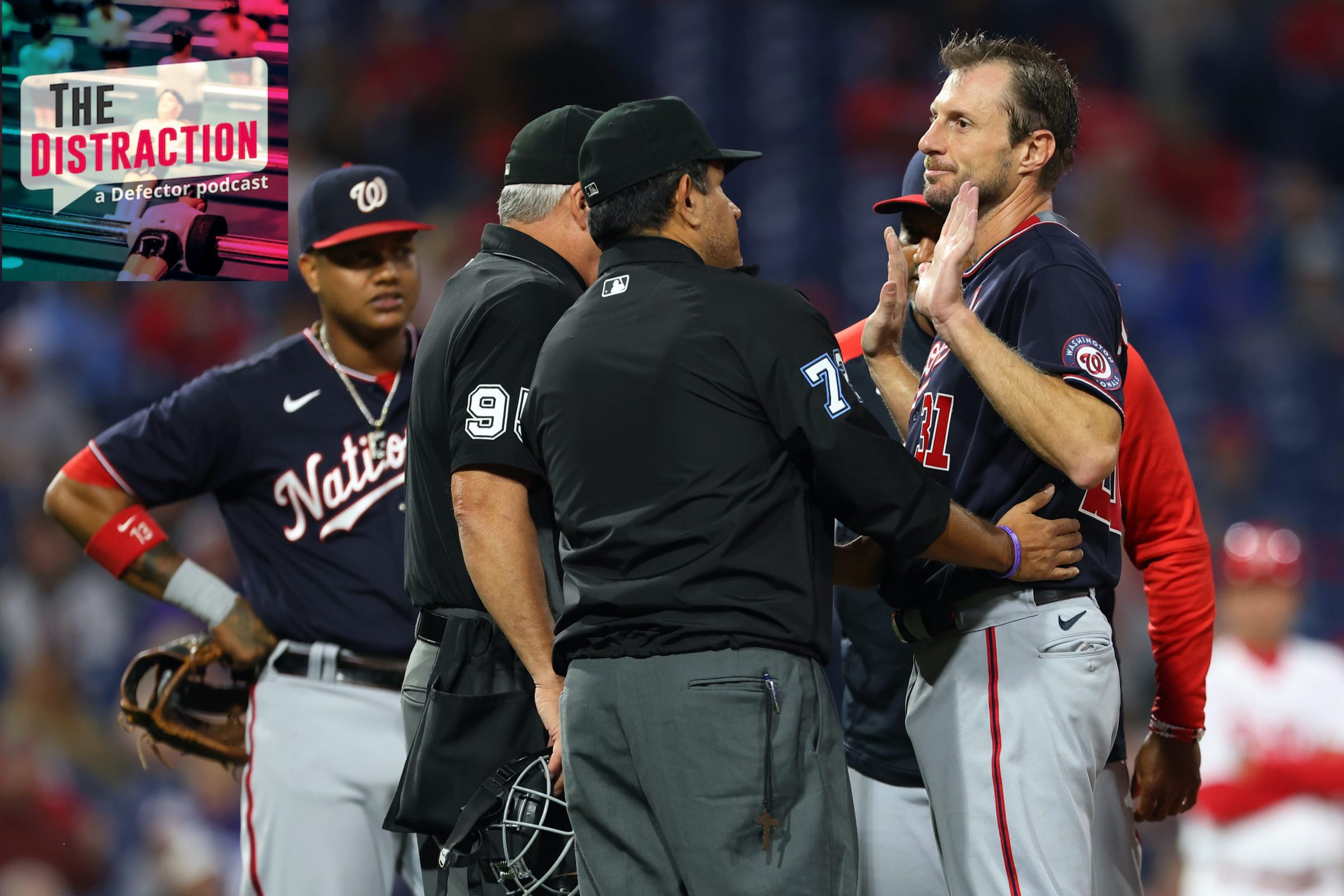 Max Scherzer of the Washington Nationals is inspected on the mound by umpire Tim Timmons during a June game.