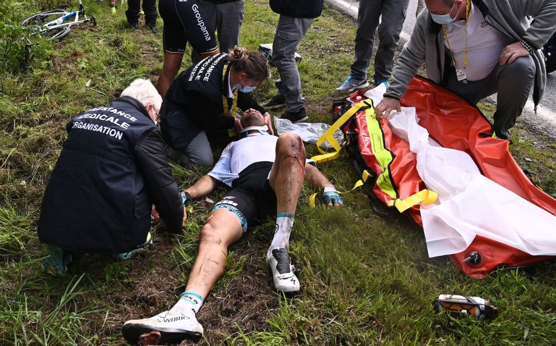 Team B&B KTM's Cyril Lemoine of France is helped by medical staff members after crashing during the 1st stage of the 108th edition of the Tour de France cycling race, 197 km between Brest and Landerneau, on June 26, 2021. (Photo by Anne-Christine POUJOULAT / POOL / AFP) (Photo by ANNE-CHRISTINE POUJOULAT/POOL/AFP via Getty Images)