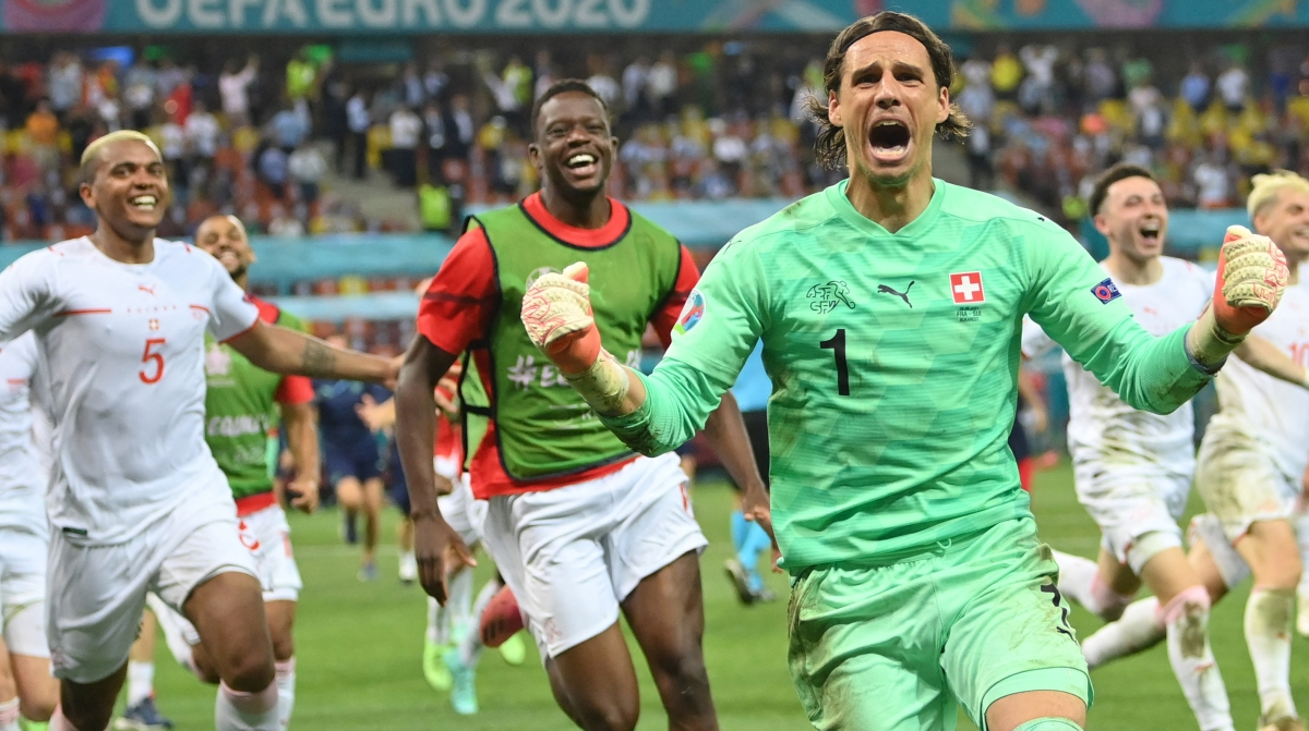 Switzerland's goalkeeper Yann Sommer reacts after saving a shot by France's forward Kylian Mbappe in the penalty shootout during the UEFA EURO 2020 round of 16 football match between France and Switzerland at the National Arena in Bucharest on June 28, 2021